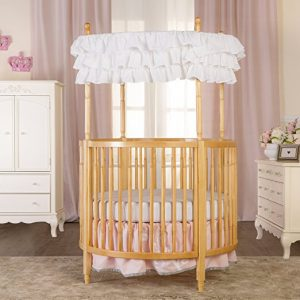 This circular crib is ideal for a little princess. You can choose from  natural or cherry in color. It does have a canopy and a non-drop side rail.